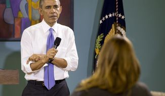 President Obama rolls up his sleeves while being asked a question about his recent executive actions on immigration at Casa Azafran in Nashville, Tenn., on Dec. 9, 2014. (Associated Press) **FILE**