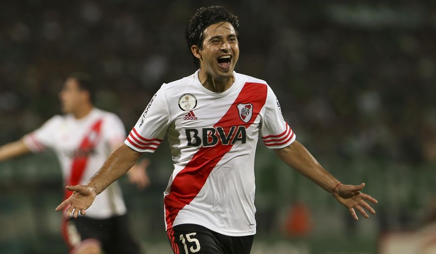 FILE - In this Dec. 3, 2014, file photo, Leonardo Pisculichi, of Argentina's River Plate, celebrates scoring his side's first goal against Colombia's Atletico Nacional during the Copa Sudamericana first leg final soccer match, in Medellin, Colombia, Wednesday. River or Nacional will have to actually win the match in order to win the cup in the upcoming game, since the away goal will not count for the final. (AP Photo/Fernando Vergara, File)