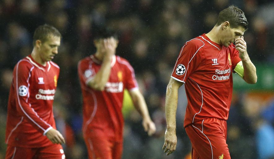 Liverpool's Steven Gerrard, right, leaves the field at half time during the Champions League Group B soccer match between Liverpool and FC Basel at Anfield Stadium in Liverpool, England, Tuesday, Dec. 9, 2014. (AP Photo/Jon Super)