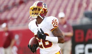 Washington Redskins cornerback Bashaud Breeland (26) warms up before the start of a preseason NFL football game against the Tampa Bay Buccaneers Thursday, Aug. 28, 2014, in Tampa, Fla. (AP Photo/Brian Blanco)
