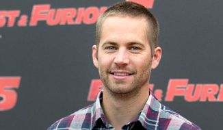 """Paul Walker 1973-2013 — the star of the """"Fast & Furious"""" movie series died in a car crash north of Los Angeles. He was 40. (AP Photo/Andrew Medichini, File)"""
