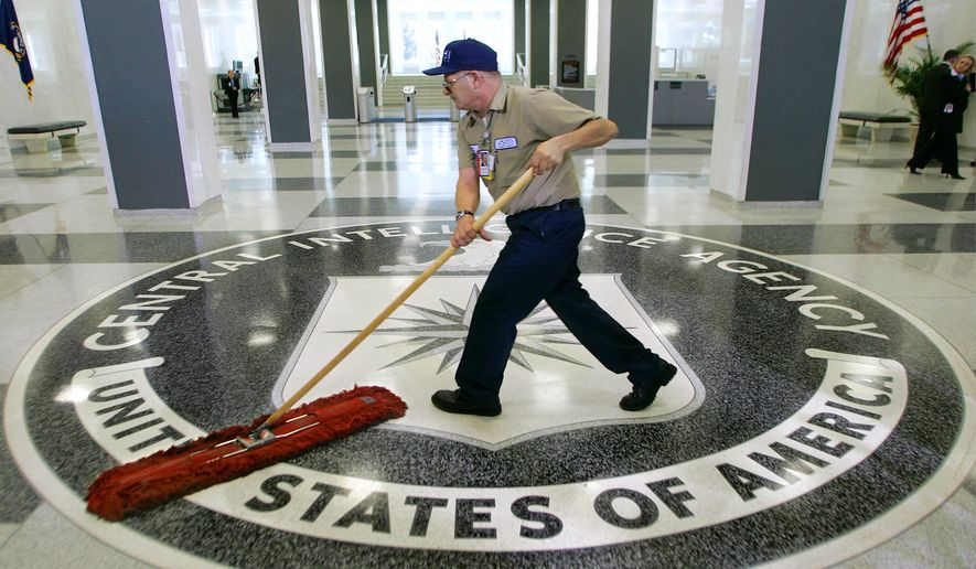 In this March 3, 2005 file photo, a workman slides a dustmop over the floor at the Central Intelligence Agency headquarters in Langley, Va. (AP Photo/J. Scott Applewhite)