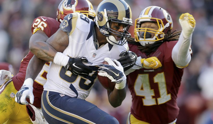 St. Louis Rams tight end Jared Cook (89) carries the ball into the end zone for a touchdown under pressure from Washington Redskins cornerback Bashaud Breeland (26) and strong safety Phillip Thomas (41) during the first half of an NFL football game in Landover, Md., Sunday, Dec. 7, 2014. (AP Photo/Patrick Semansky)