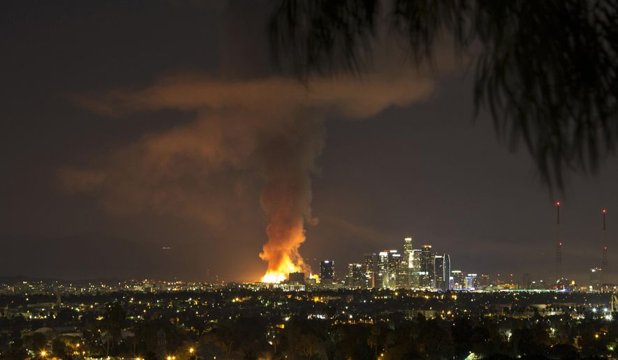 This photo provided by Nancy Yuille shows a massive fire engulfing an apartment building construction site near downtown Los Angeles on Monday, Dec. 8, 2014. Crews battled two large fires in Los Angeles early Monday, including a massive one downtown that closed portions of two major freeways and blanketed the area in ash and heavy smoke. (AP Photo/Nancy Yuille)