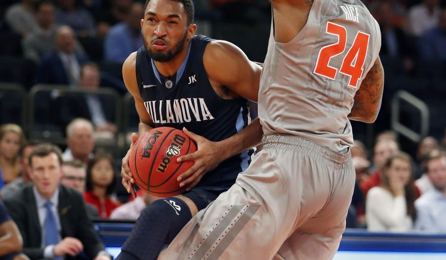 Illinois guard Rayvonte Rice (24) defends Villanova guard Darrun Hilliard II in the second half of an NCAA basketball game at Madison Square Garden in New York, Tuesday, Dec. 9, 2014. (AP Photo/Kathy Willens)