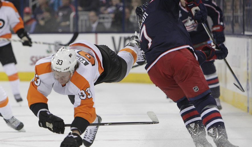 Columbus Blue Jackets' Jack Johnson, right, checks Philadelphia Flyers' Jakub Voracek, of the Czech Republic, during the first period of an NHL hockey game Tuesday, Dec. 9, 2014, in Columbus, Ohio. (AP Photo/Jay LaPrete)