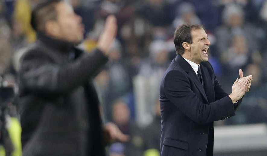 Juventus coach Massimiliano Allegri, right, applauds as Atletico's coach Diego Simeone gestures during a Champions League, Group A, soccer match between Juventus and Atletico de Madrid at the Juventus stadium in Turin, Italy, Tuesday, Dec. 9, 2014. (AP Photo/Antonio Calanni)