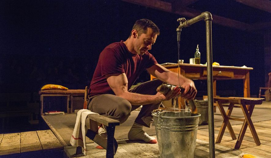 "FILE - This 2014 file photo provided by Boneau/Bryan-Brown shows Hugh Jackman as The Man in ""The River,"" a play by Jez Butterworth, directed by Ian Rickson, at Circle in the Square Theatre in New York. Before Jackman appeared in his current Broadway play ""The River,"" he had to learn his lines, dig deep into his character and do something he's never done before: gut a fish. (AP Photo/Boneau/Bryan-Brown, Richard Termine, File)"