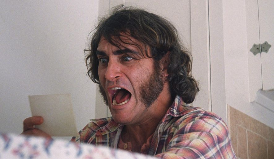 "This photo provided by courtesy of Warner Bros. Pictures shows Joaquin Phoenix as Larry ""Doc"" Sportello in Warner Bros. Pictures' and IAC Films' ""Inherent Vice,"" a Warner Bros. Pictures release. The film releases on Dec. 12, 2014. (AP Photo/Warner Bros. Pictures)"