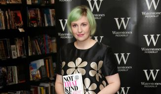 "Actress Lena Dunham holds her memoir, ""Not That Kind Of Girl,"" ahead of a book signing at Waterstones book shop, Piccadilly, in central London, in this Oct. 29, 2014, file photo. (Photo by Joel Ryan/Invision/AP, File)"