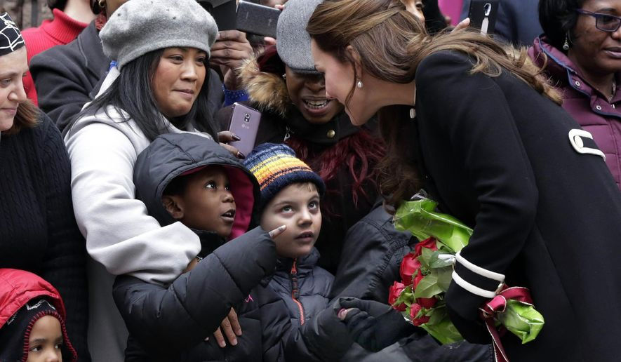 Kate, Duchess of Cambridge greets children and parents outside the Northside Center after her visit, in New York, Monday, Dec. 8, 2014. Kate and Prince William are on a three-day visit to the U.S., their first official visit since a 2011 trip to California. (AP Photo/Richard Drew)