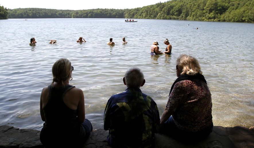 The simple, serene place that inspired Henry David Thoreau's work the most is going solar. (AP Photo/Steven Senne, File)