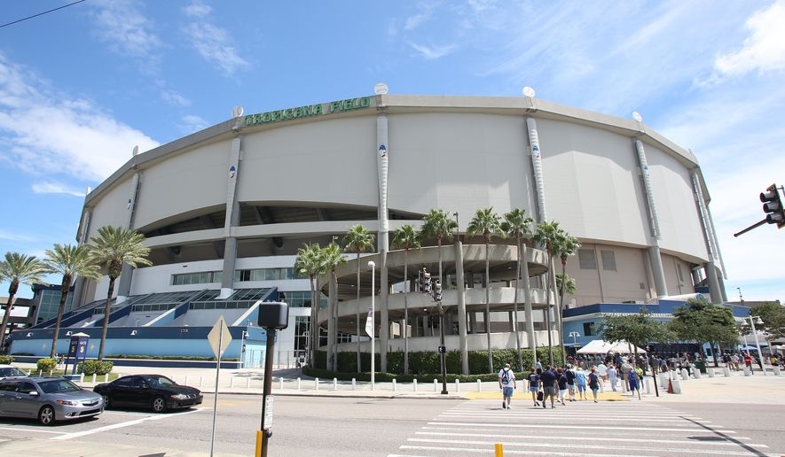 FILE - This is a Sept. 21, 2014, file photo showing Tropicana Field,  before a baseball game between the Chicago White Sox and Tampa Bay Rays, in St. Petersburg, Fla. The Rays have reached a deal with St. Petersburg that would allow the team to search for new stadium sites on both sides of Tampa Bay. The team has played since its inception in Pinellas County at what now is called Tropicana Field. The agreement, slated for a vote Thursday, Dec. 11, by the St. Petersburg City Council, would allow the Rays to evaluate sites on the east side of the bay in Hillsborough County, where Tampa is located.  (AP Photo/Reinhold Matay, File)