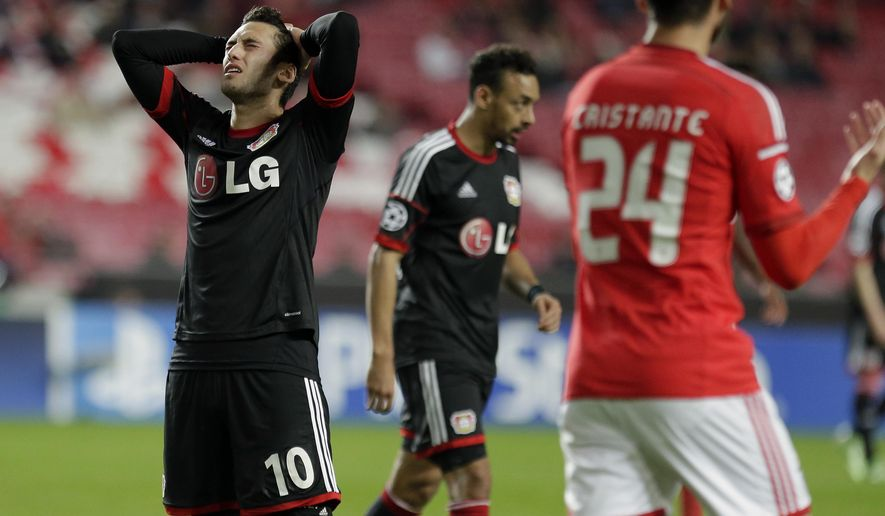 Leverkusen's Hakan Calhanoglu, left, reacts during a Champions League Group C soccer match between SL Benfica and Bayer 04 Leverkusen in Lisbon, Portugal, Tuesday, Dec. 9, 2014. (AP Photo/Francisco Seco)