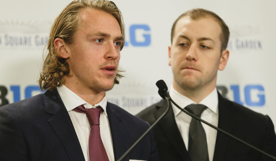 New York Rangers' Carl Hagelin, left, speaks as teammate Derek Stepan, right, looks on, during a news conference to announce a partnership with Madison Square Garden and the Big Ten Conference Tuesday, Dec. 9, 2014, in New York.  (AP Photo/Frank Franklin II)