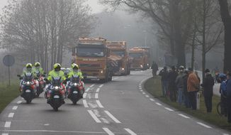 Trucks carrying the wreckage of downed Malaysia Airlines flight MH17 arrive at Gilze-Rijen military base, Netherlands, Tuesday, Dec. 9, 2014. (AP Photo/Peter Dejong) ** FILE **