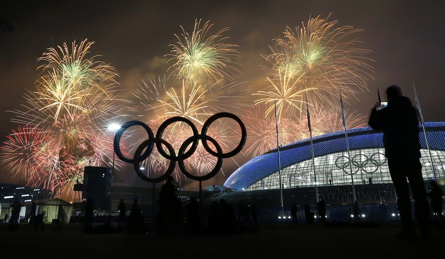 FILE - In this Feb. 23, 2014 file photo, a man takes a photograph of fireworks during the closing ceremony of the 2014 Winter Olympics, in Sochi, Russia. The Sochi Winter Olympics placed tenth on Facebook's list of most popular topics worldwide in 2014, based on the number of posts, comments, likes, photos and videos shared. (AP Photo/Petr David Josek, File)