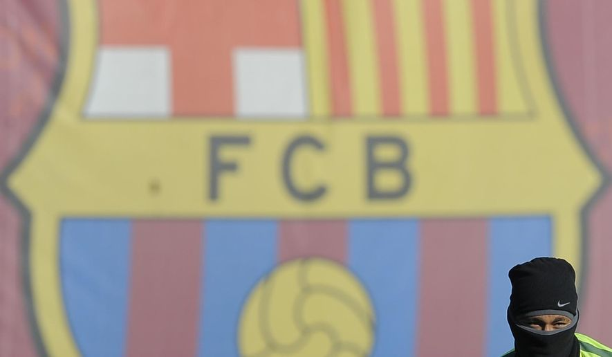 FC Barcelona's Neymar, from Brazil, attends a training session at the Sports Center FC Barcelona Joan Gamper in San Joan Despi, Spain, Tuesday, Dec. 9, 2014.  FC Barcelona will play against PSG in a group F Champions League on Wednesday Dec. 10. (AP Photo/Manu Fernandez)