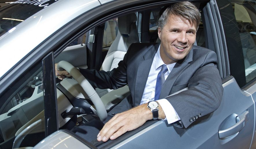 In this Sept. 18, 2013 file photo  Harald Krueger, production executive and member of the board of car manufacturer BMW sits in a new BMW i3 car during the official start of the large-volume production at the plant of German luxury automaker BMW AG in Leipzig, central Germany. Krueger will take over the post of BMW's CEO from Norbert Reithofer who will become the company's chairman of the board as they announced Tuesday, Dec. 9, 2014. (AP Photo/Jens Meyer, File)