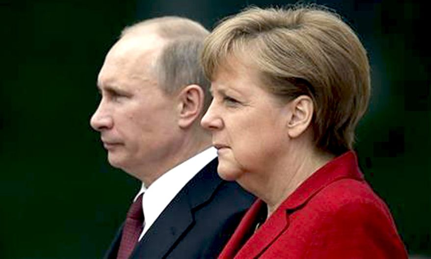 German Chancellor Angela Merkel, right, welcomes President of Russia Vladimir Putin, left, at the chancellery in Berlin, Germany, June 1, 2012. (Associated Press) ** FILE **