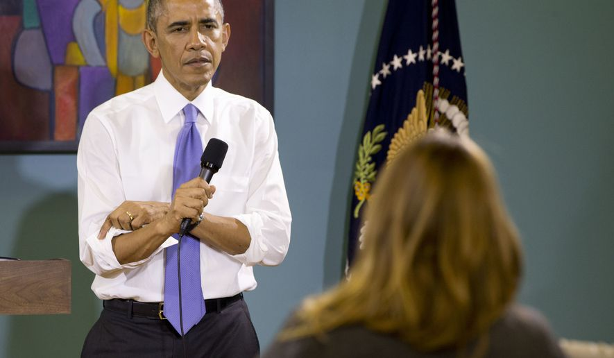 President Barack Obama rolls up his sleeves while being asked a question about his recent executive actions on immigration, Tuesday, Dec. 9, 2014, at Casa Azafran in Nashville, Tenn. (AP Photo/Jacquelyn Martin)