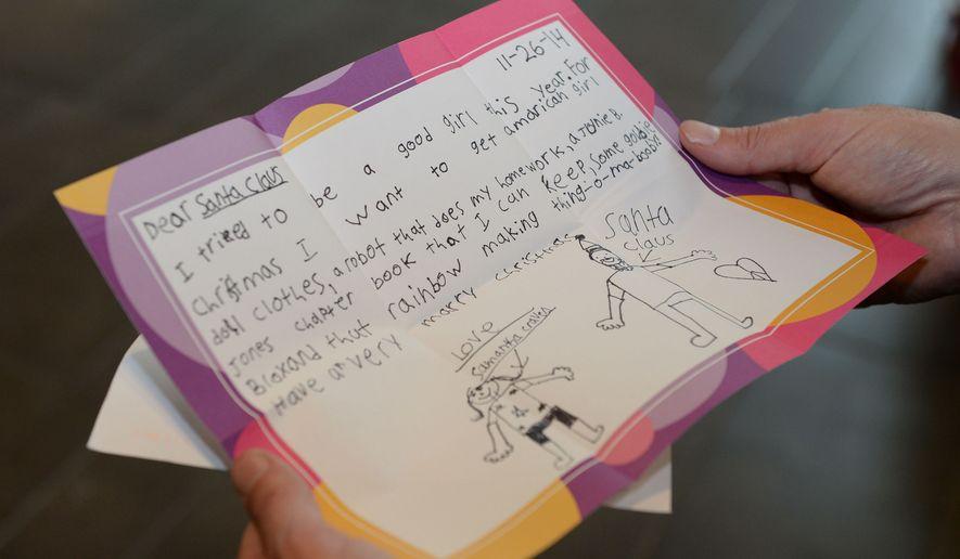 A girl's Christmas list letter to Santa Claus. (AP Photo/The Daily Gazette, Patrick Dodson)