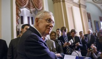 Outgoing Senate Majority Leader Harry Reid of Nevada meets with reporters on Capitol Hill in Washington, Tuesday, Dec. 9, 2014. (AP Photo/J. Scott Applewhite)