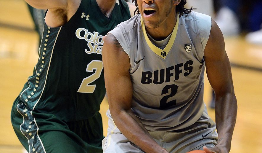 Colorado's Xavier Johnson, goes up fro a dunk on Colorado State's Daniel Bejarano, during the second half of an NCAA college basketball game, Wednesday, Dec. 10, 2014 in Boulder, Colo. (AP Photo/The Daily Camera, Cliff Grassmick) NO SALES