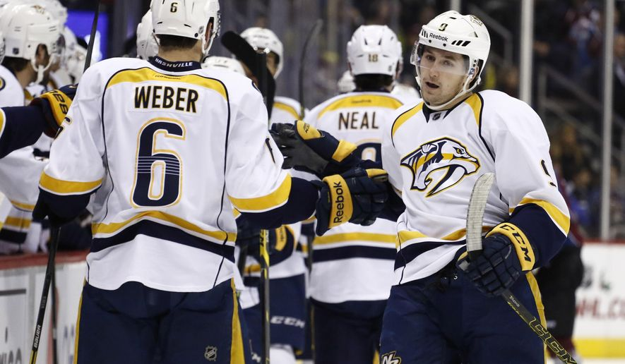 Nashville Predators center Filip Forsberg (9) celebrates his goal against the Colorado Avalanche with teammate Shea Weber (6) during the first period of an NHL hockey game Tuesday, Dec. 9, 2014, in Denver. (AP Photo/Jack Dempsey)