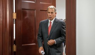 """Without a threat of a government shutdown, this sets up a direct challenge to the president's unilateral actions on immigration when we have new majorities in both chambers of Congress,"" House Speaker John A. Boehner of Ohio told reporters after meeting in a closed-door session with his Republican caucus on Capitol Hill. Lawmakers face a midnight deadline to pass a budget. (Associated Press photographs)"