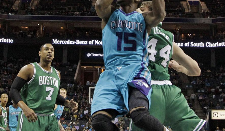 Charlotte Hornets' Kemba Walker (15) drives past Boston Celtics' Tyler Zeller (44) during the first half of an NBA basketball game in Charlotte, N.C., Wednesday, Dec. 10, 2014. (AP Photo/Chuck Burton)