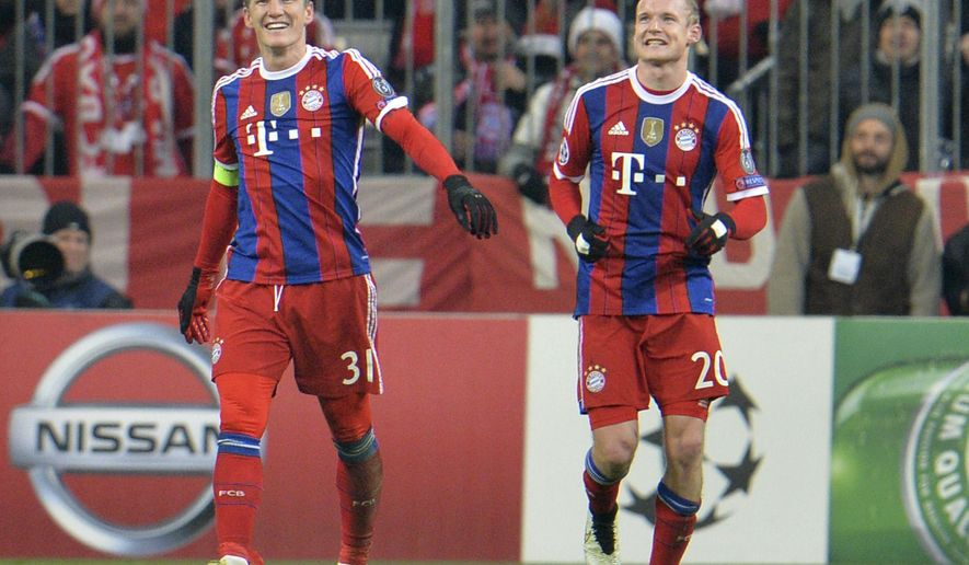 Bayern's Sebastian Rode, right, is congratulated by his teammate Bastian Schweinsteiger after he scored his side's second goal during the Champions League group E soccer match between FC Bayern Munich and CSKA Moscov in Munich, Germany, Wednesday, Dec. 10, 2014. (AP Photo/Kerstin Joensson)