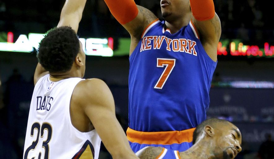 A flagrant foul is called on New Orleans Pelicans forward Anthony Davis (23) as he bumps into New York Knicks guard J.R. Smith (8) while trying to defend forward Carmelo Anthony (7) in the first half of an NBA basketball game in New Orleans, Tuesday, Dec. 9, 2014. (AP Photo/Jonathan Bachman)