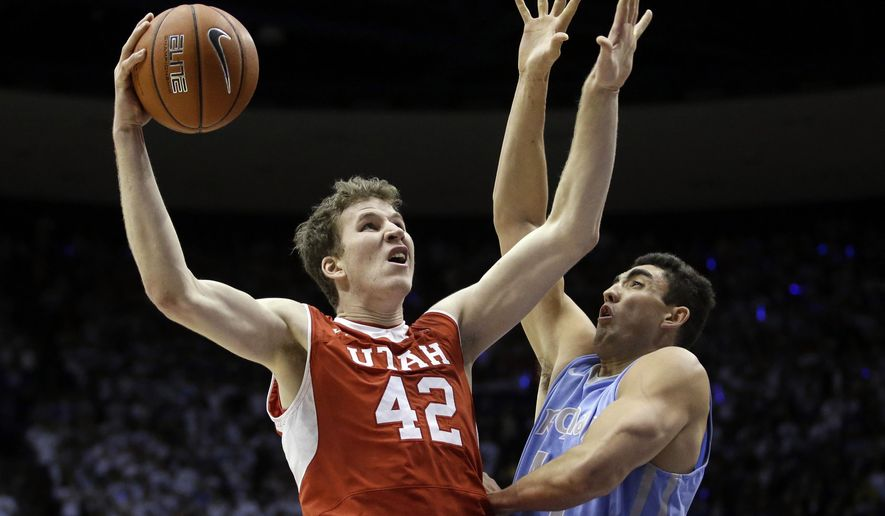 Utah forward Jakob Poeltl (42) shoots as BYU center Corbin Kaufusi (44) defends in the first half of an NCAA college basketball game Wednesday, Dec. 10, 2014, in Provo, Utah. (AP Photo/Rick Bowmer)