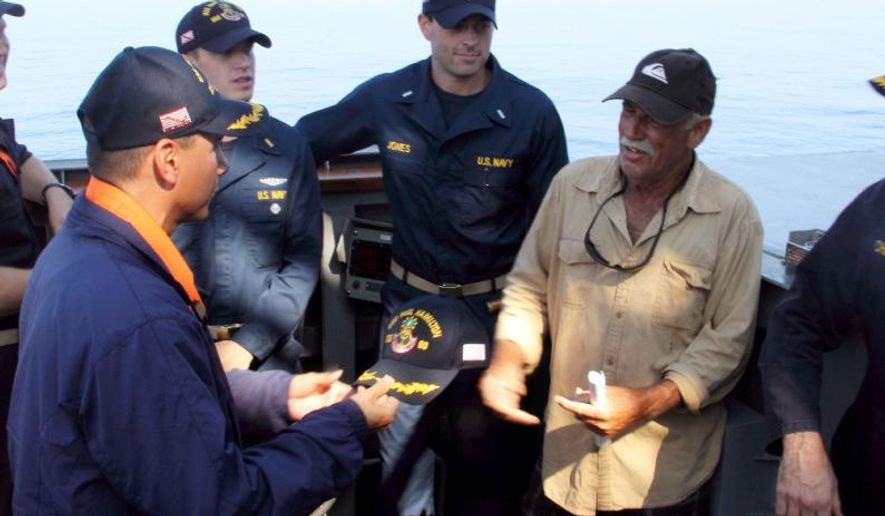 In this photo provided by the U.S. Navy, Cmdr. John Barsano, welcomes Ron Ingraham aboard the Arleigh Burke-class guided-missile destroyer USS Paul Hamilton (DDG 60) after rescuing him on Tuesday, Dec. 9, 2014 near Hawaii.  Ingraham, 67, was found dehydrated and hungry after going missing on Thanksgiving, when the Coast Guard picked up his mayday call saying his boat was in danger of sinking. (AP Photo/U.S. Navy)