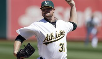 FILE - In this Sept. 3, 2014, file photo, Oakland Athletics pitcher Jon Lester throws against the Seattle Mariners during the first inning of a baseball game in Oakland, Calif. A person familiar with the negotiations says pitcher Lester has agreed to a $155 million, six-year contract with the Chicago Cubs. The person spoke on condition of anonymity Tuesday, Dec. 9, because the agreement had not been announced. (AP Photo/Jeff Chiu, File)