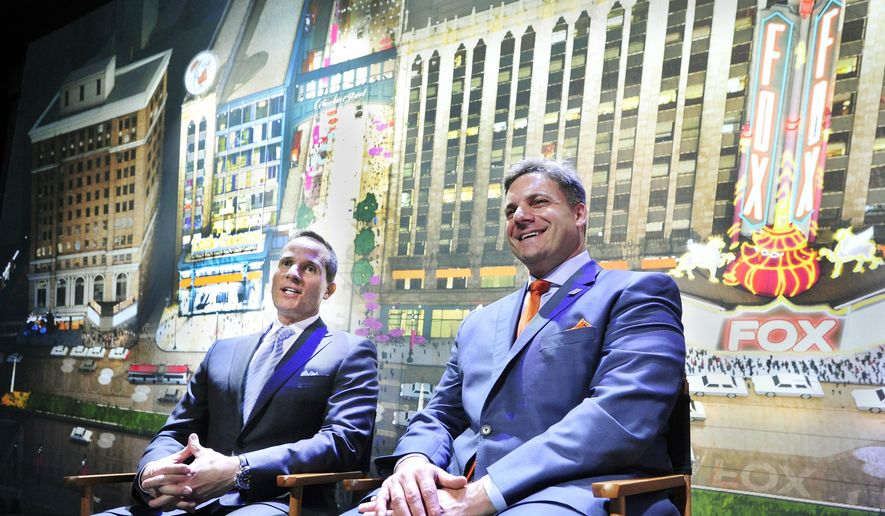 Christopher Ilitch, left, President and CEO of Ilitch Holdings, and David Scrivano, President and CEO of Little Caesars, discuss the company's new project Little Caesars Global Resource Center during a news conference Wednesday, Dec. 10, 2014, in Detroit. The 205,000-square-foot center will be next to the Fox Theatre and part of a larger sports and entertainment district just north of downtown.  (AP Photo/Detroit News, Daniel Mears)  DETROIT FREE PRESS OUT; HUFFINGTON POST OUT; MAGS OUT