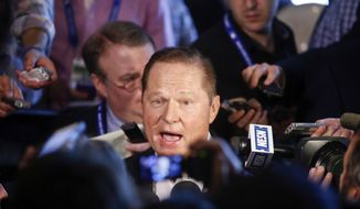 Agent Scott Boras talks during a news conference in the lobby of a hotel at the Major League Baseball winter meetings Wednesday, Dec. 10, 2014, in San Diego. (AP Photo/Lenny Ignelzi)
