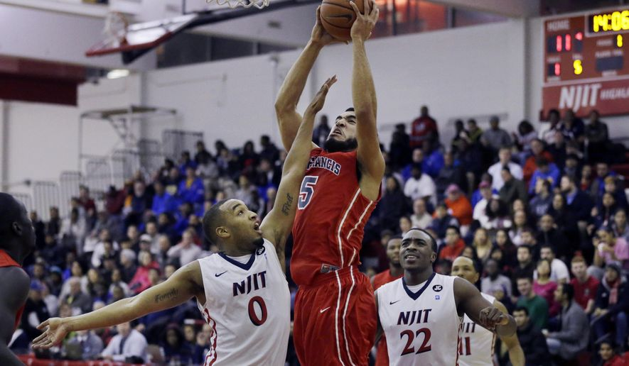 NJIT's Ky Howard (0) tries to block a shot by St. Francis of Brooklyn's  Jalen Cannon (5) during the first half of an NCAA college basketball game Tuesday, Dec. 9, 2014, in Newark, N.J. (AP Photo/Mel Evans)