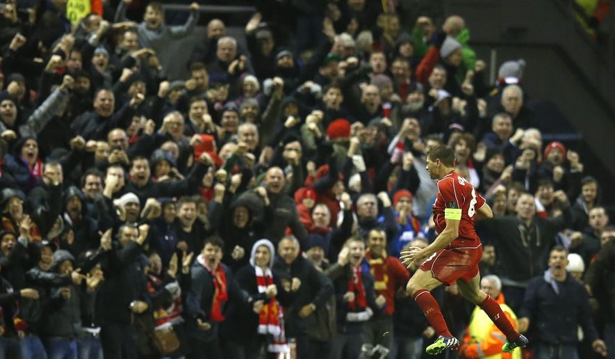 Liverpool's Steven Gerrard celebrates after scoring his side's first goal during the Champions League Group B soccer match between Liverpool and FC Basel at Anfield Stadium in Liverpool, England, Tuesday, Dec. 9, 2014. (AP Photo/Jon Super)