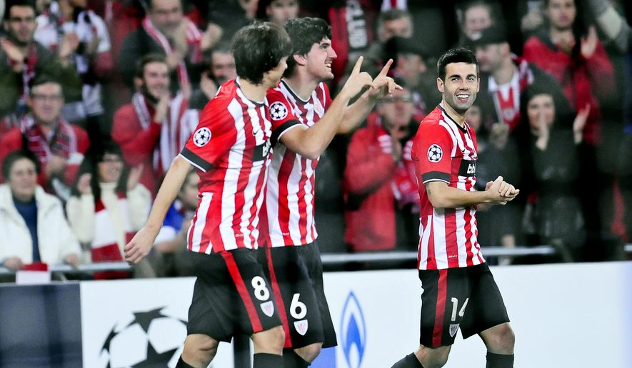 Athletic Bilbao's Mikel San Jose, center, celebrates after scoring his goal against FC BATE BorisoV, during the Champions League Group H soccer match between Athletic Bilbao and FC BATE Borisov, at San Mames stadium, in Bilbao, northern Spain, Wednesday, Dec.10, 2014. (AP Photo/Alvaro Barrientos)