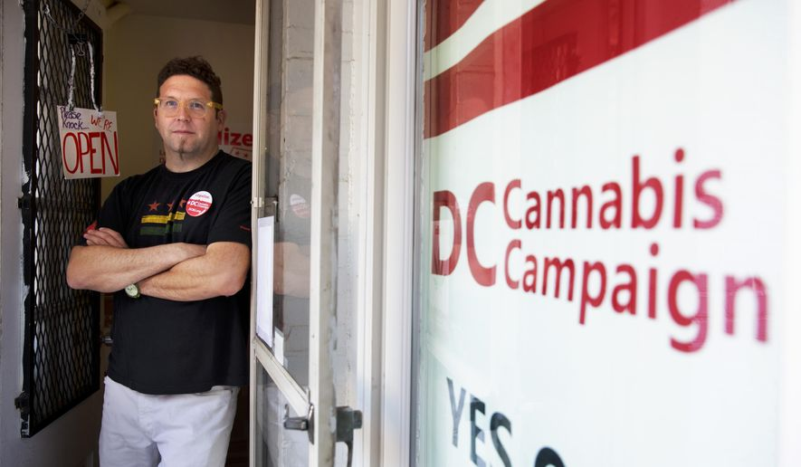 FILE - In this Oct. 9, 2014 file photo, Adam Eidinger, chairman of the DC Cannabis Campaign, poses for a portrait at the DC Cannabis Campaign headquarters in Washington. A debate over legalizing marijuana in the nation's capital is focusing on the outsized number of arrests of African Americans on minor drug charges. Pot legalization supporters in Colorado and Washington state also spoke about racial justice, but their voters are mostly white and their campaigns focused more on other issues. The race factor hits closer to many more homes in the District, where nearly half the population is black.  (AP Photo/Jacquelyn Martin, File)