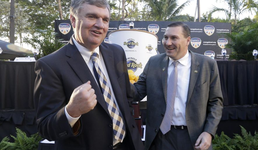 Georgia Tech Head Coach Paul Johnson, left, and Mississippi State Head Coach Dan Mullen, right, have a light moment after a news conference in Hollywood, Fla., Wednesday, Dec. 10, 2014. After climbing three spots in the final CFP rankings and leapfrogging Michigan State, the Bulldogs will be at Sun Life Stadium on Dec. 31 to take on Georgia Tech at the Orange Bowl football classic, the first meeting between those programs since 2009. (AP Photo/Alan Diaz)
