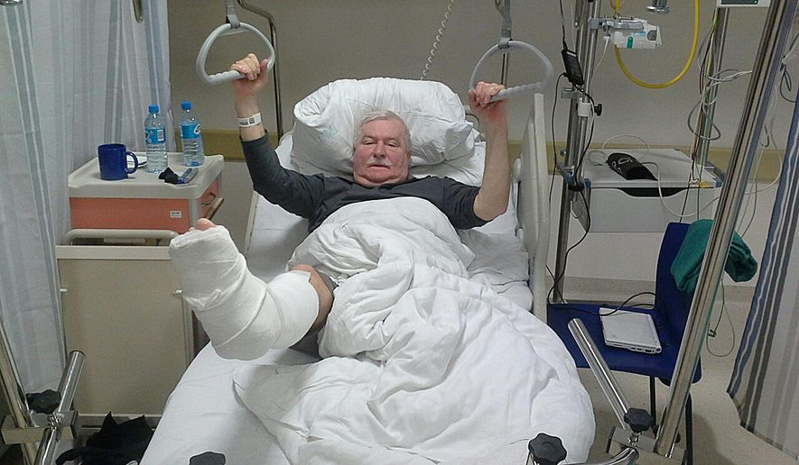 The photo provided by the blog of  Lech Walesa, the former Polish democracy leader and former president, shows him recovering in a hospital after breaking his leg while leaving a church in Gdansk, Poland, on Tuesday Dec. 9,  2014. Walesa, 71, broke his right leg on Tuesday while leaving a church in his hometown of Gdansk. (AP Photo/www.wykop.pl/ludzie/lechwalesa/)