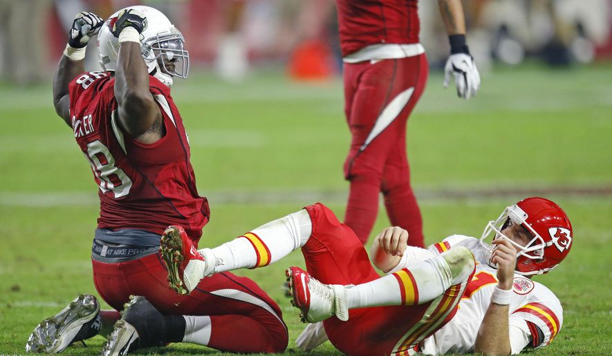 Arizona Cardinals defensive end Frostee Rucker (98) celebrates his sack of Kansas City Chiefs quarterback Alex Smith (11)  in the fourth quarter of an NFL football game Sunday, Dec. 7, 2014, in Glendale, Ariz.  The Cardinals defeated the Chiefs 17-14. (AP Photo/The Arizona Republic, David Kadlubowski)  MARICOPA COUNTY OUT; MAGS OUT; NO SALES