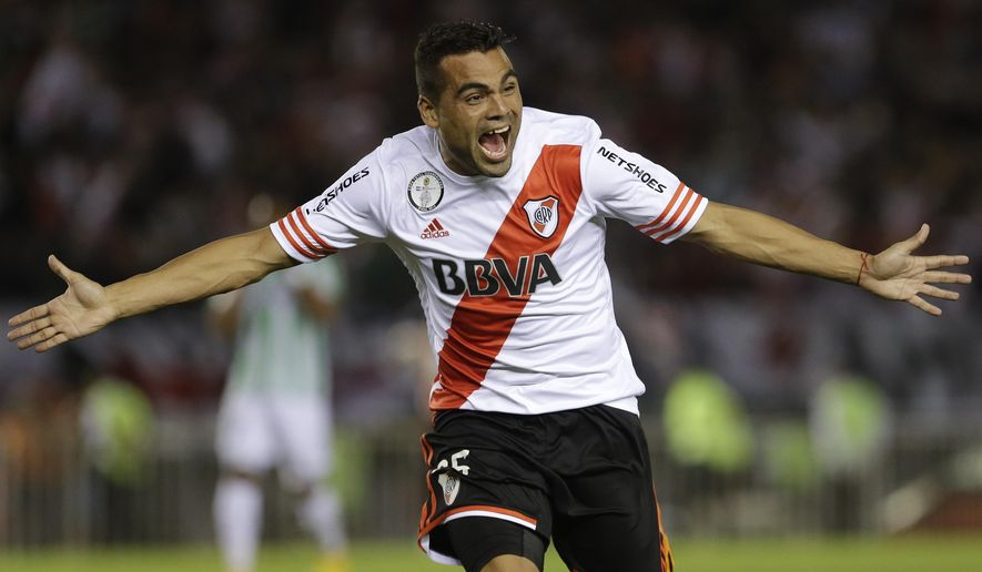 Argentina's River Plate's Gabriel Mercado celebrates his goal against Colombia's Atletico Nacional during the Copa Sudamericana second-leg final soccer match in Buenos Aires, Argentina, Wednesday, Dec. 10, 2014. River Plate won the match 2-0 and the tournament. (AP Photo/Victor R. Caivano)