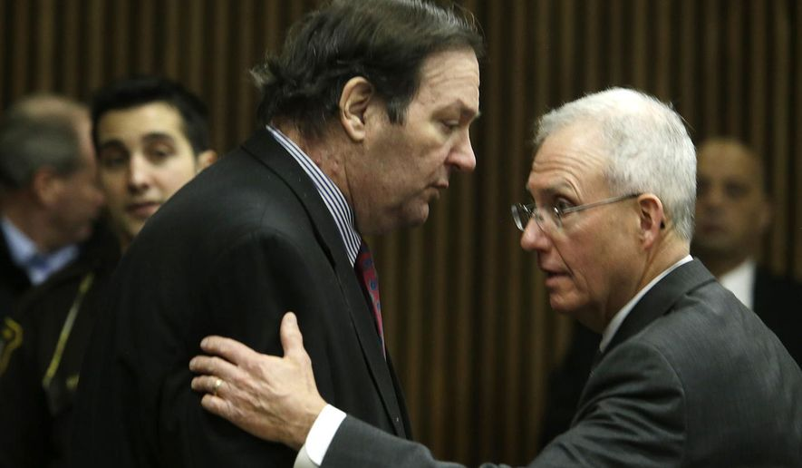 Bob Bashara, left,  speaks to his attorney Michael McCarthy during a break during closing arguments in this trial in the Wayne County 3rd Circuit courtroom Wednesday, Dec. 10, 2014, in Detroit. Bashara, a former Rotary Club president arranged to have his wife killed because his marriage was colliding with his desire to indulge in bondage and masochism with other women, a prosecutor told jurors Wednesday at the conclusion of a long trial that revealed a secret life in suburban Detroit.  (AP Photo/Detroit Free Press, Mandi Wright)  DETROIT NEWS OUT;  NO SALES Mandi Wright/Detroit Free Press