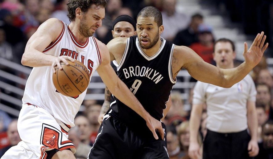 Chicago Bulls Pau Gasol (16) drives against Brooklyn Nets Jerome Jordan (9) during the first half of an NBA basketball game in Chicago on Wednesday, Dec. 10, 2014. (AP Photo/Nam Y. Huh)