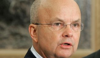 """Then-Air Force Gen. Michael Hayden speaks in the Oval Office at the White House in Washington after President Bush announced he was his choice to replace outgoing CIA Director Porter Goss. The head of the CIA during President George W. Bush's second term says """"I didn't lie"""" to Congress about harsh interrogations of terrorism suspects. Retired Gen. Michael Hayden does say the intelligence community labored after Sept. 11, 2001 to repel further attacks against the U.S.  (AP Photo/Ron Edmonds, File)"""