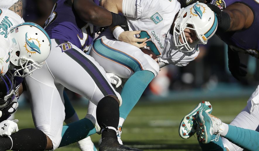 Miami Dolphins quarterback Ryan Tannehill (17) is sacked by Baltimore Ravens outside linebacker Elvis Dumervil (58) during the second half of an NFL football game, Sunday, Dec. 7, 2014, in Miami Gardens, Fla. (AP Photo/Wilfredo Lee)